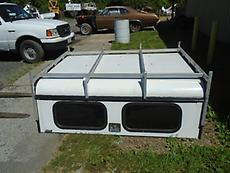2009 A.R.E. CAMPER TOP W/ TOOL COMPARTMENT & LADDER RACK